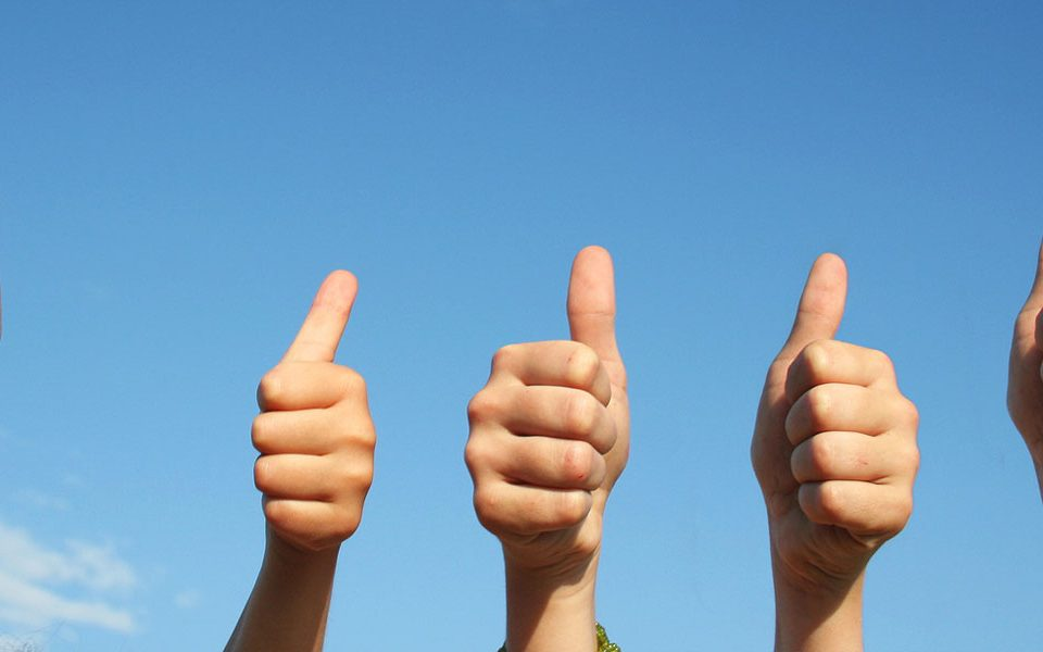 thumbs up with blue sky