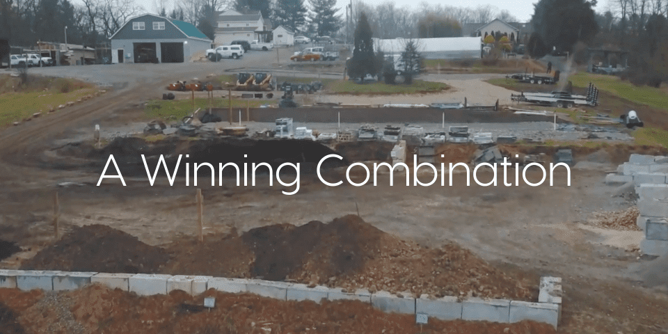 """"""" A Winning-Combination"""" text over image of wall foundation"""