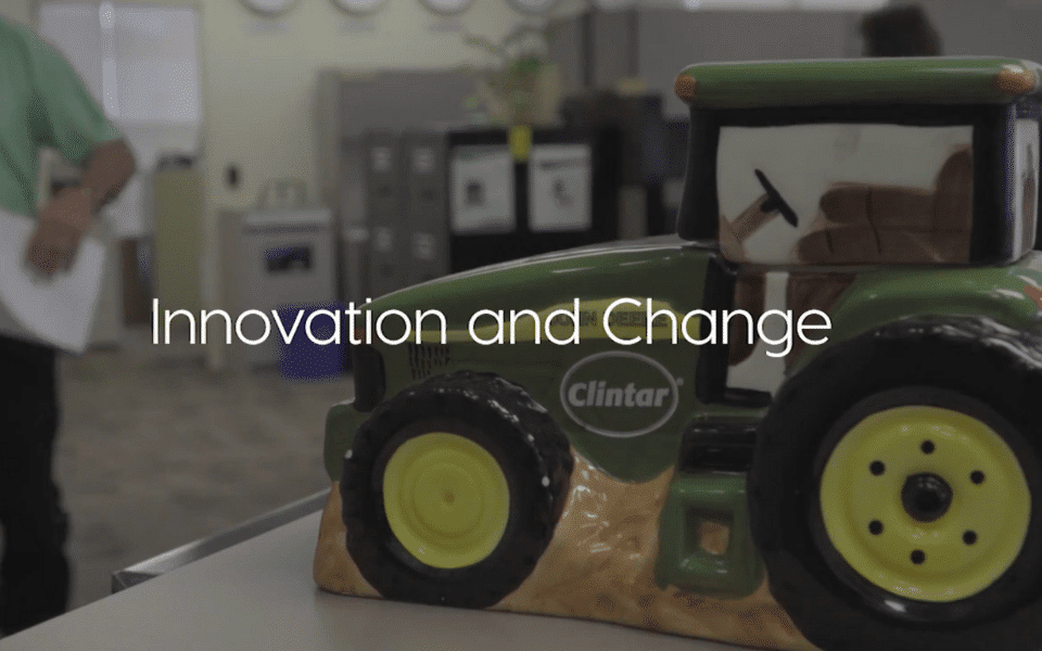 """""""Innovation and Change"""" - text over image of toy tractor on desk"""