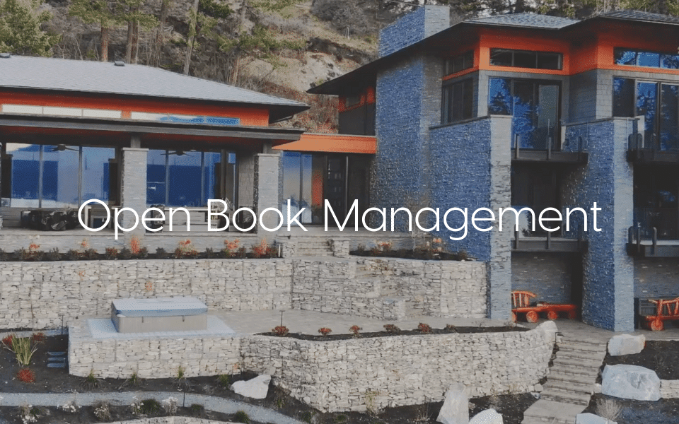 """""""Open Book Management"""" - Text over image of stone scape"""
