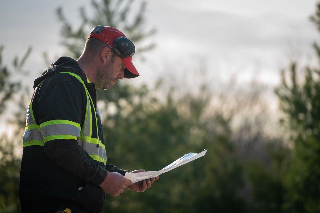 Landscape business owner planning out a work order
