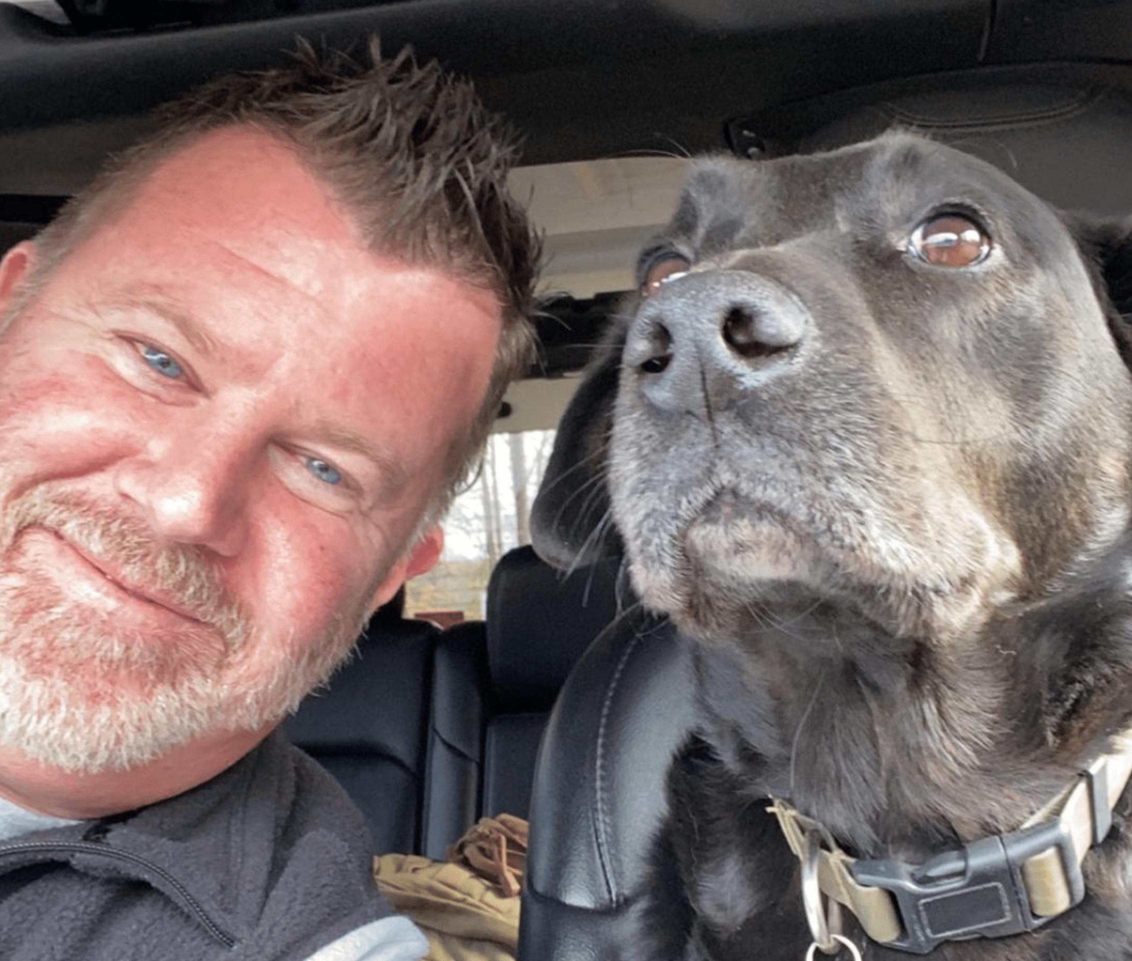 Eric Jones driving his dog before work.