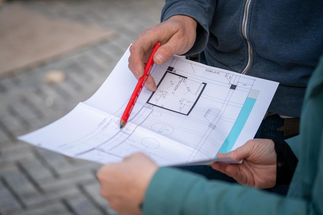 A landscape entrepreneur planning out their job_ the costs_ and the profit margin